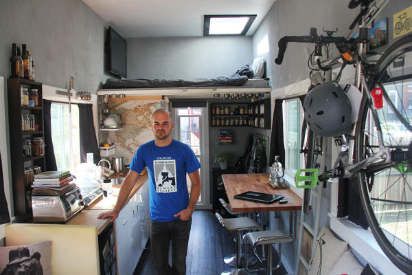 Jay Austin's tiny house in Washington, D.C., has 10-foot ceilings, a loft bed over the bathroom and a galley-style kitchen.