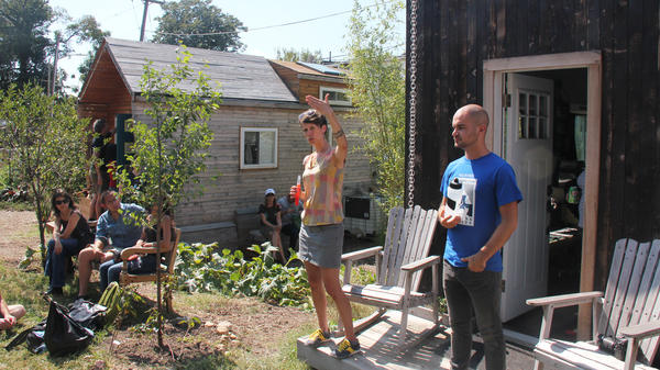 Lee Pera (left) and Jay Austin conduct a seminar on tiny house building at Boneyard Studios, a former tiny home showcase community in Washington, D.C. The community has since split, and the homes on the space have been moved to separate lots.