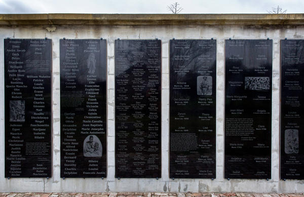 A memorial wall at the museum is etched with the names of the 356 people who were enslaved on the plantation.