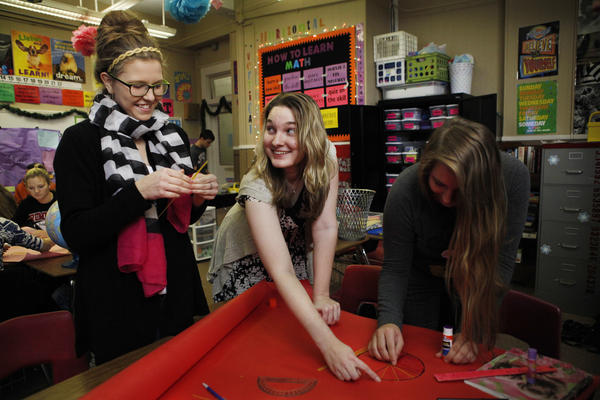 For her trigonometry class, Sarah Hagan (center) uses everything but the kitchen sink: a flower pot, garbage basket, rolls of tape, rubber balls, even loose spaghetti.