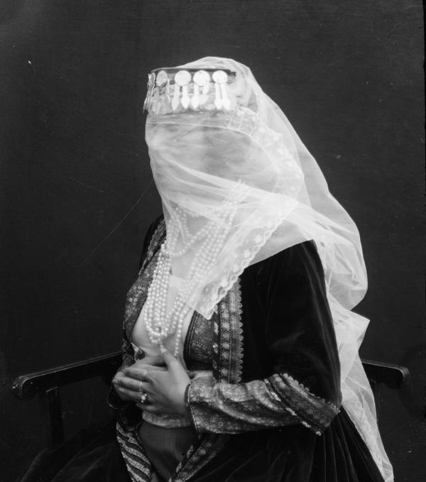 A woman wears a veil and pearls. The image is part of the Freer and Sackler Galleries' Antoin Sevruguin collection. It's one of the most prominent of its kind in North America.