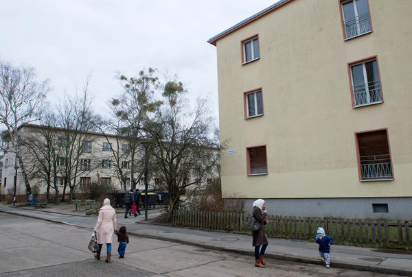 Refugees walk along on a street near the Initial Reception Camp Marienfelde in Berlin, Germany, in January. Marienfelde camp has been a transitional home for refugees in Germany for more than 60 years. But the recent influx of asylum-seekers is straining the system.
