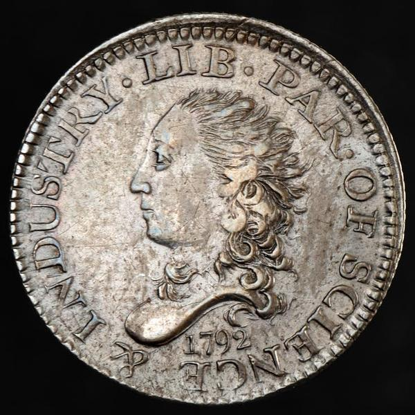 The head side of a 1792 Half Disme. Disme is the antiquated manner of 'dime.' (Courtesy of American Numismatic Association)