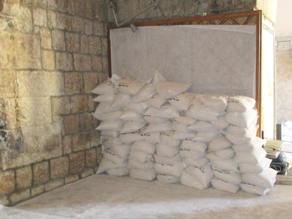 Sandbags are  stacked on the inside walls of the Ma'arra museum, shielding fragile, ancient mosaics from the blast of regime jets and looters.