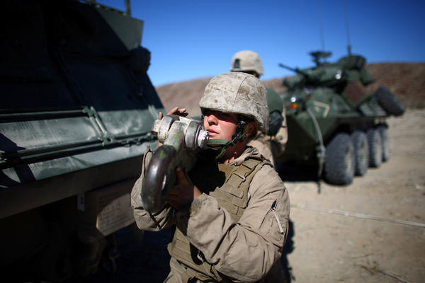 Lance Cpl. Julia Carroll holds a tow bar after pulling an LAV.