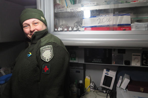 """""""Mama,"""" like many members of the Right Sector militia in Ukraine's Pisky village, goes only by her nickname.  She stands inside the donated American ambulance that serves as a medical station for wounded troops."""