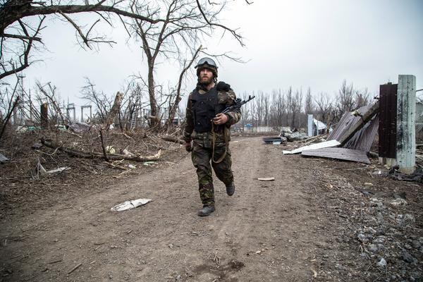 A Ukrainian serviceman walks in the village of Pisky in the region of Donetsk controlled by Ukrainian forces on Feb. 26.