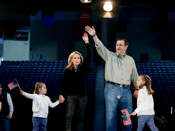 Sen. Ted Cruz, his wife, Heidi, and their two daughters Catherine (left) and Caroline practice waving on stage at Liberty University before Cruz's Monday presidential campaign launch.