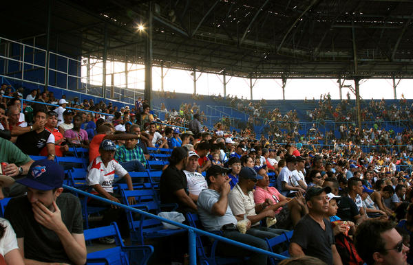 The crowd at Latin American Stadium watches a game.
