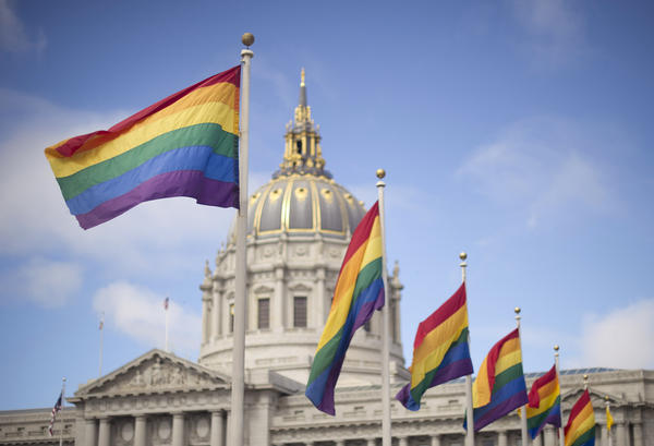 Rainbow flags fly in front of San Francisco City Hall in 2013 after the U.S. Supreme Court cleared the way for same-sex marriage in California.
