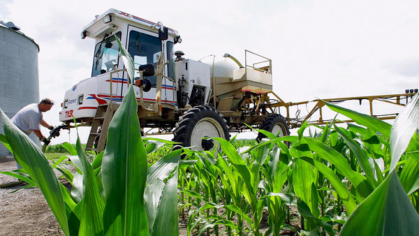 Central Illinois corn farmer Jerry McCulley refills his sprayer with the weedkiller glyphosate on a farm near Auburn, Ill. A new assessment of the chemical finds that the (uncertain) risks mainly affect the people who work with it or who come in direct contact with areas where it's applied.