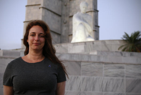 Cuban artist Tania Bruguera poses for a photograph near the statue of José Martí in Havana's Revolution Plaza. She was arrested in December for planning a political performance there.