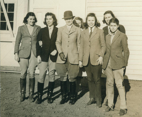 Professor Harriet Rogers with riding students at Sweet Briar, circa 1940. The school was noted for its equestrian program.