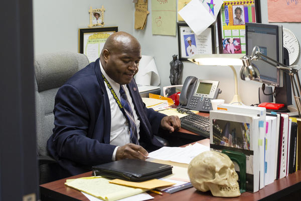 Williams at his desk in the Richmond, Va., police department. Today, the city's homicide clearance rate routinely hits percentages in the 80s and 90s.