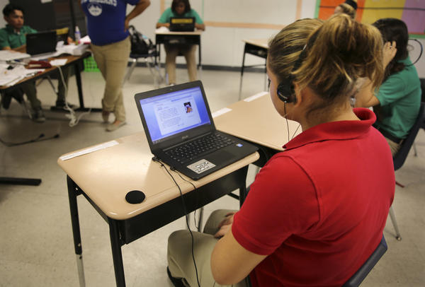 G.W. Carver Preparatory Academy has enrolled more than 50 unaccompanied minors from Central America. Principal Ben Davis says he's spending an extra $2,500 per student for special education services and instructional software tailored for them.