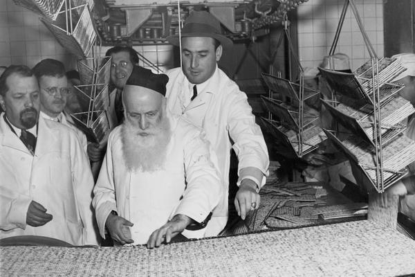 A rabbi (center) supervises the production of Passover matzos at the Streit's factory on New York's Lower East Side, circa 1960s. This Passover will be Streit's last one at the landmark location.