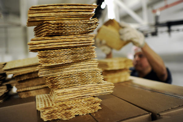 A worker stacks matzo wafers at Streit's matzo factory on the Lower East Side of New York in 2012.