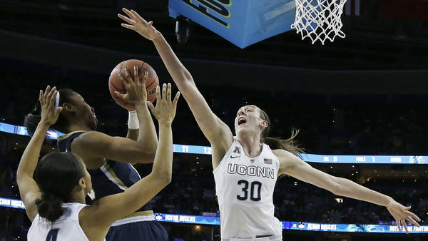 Notre Dame guard Lindsay Allen shoots against Connecticut forward Breanna Stewart as Connecticut guard Moriah Jefferson looks on April 7 during the first half of the NCAA women's college basketball championship game in Tampa, Fla.
