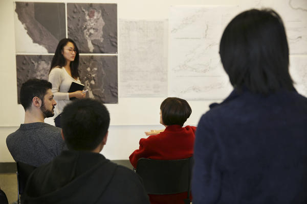 A student presents a topographical drawing in Agrest's Architecture of Nature/Nature of Architecture class.