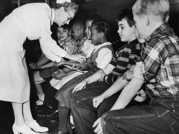 A nurse prepares children for a polio vaccine shot as part of citywide testing of the vaccine on elementary school students in Pittsburgh in 1954.