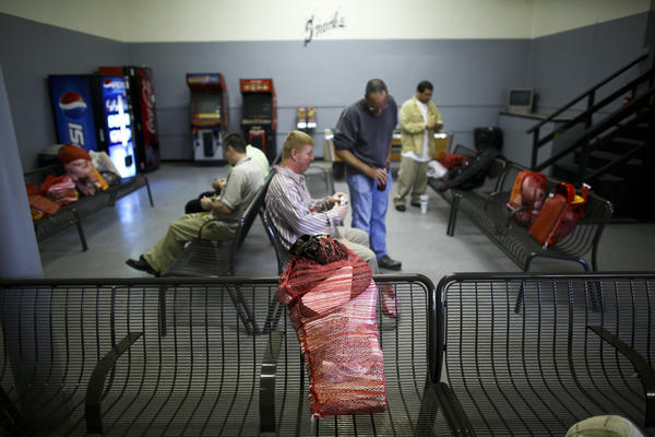 In the waiting room in the Huntsville Greyhound station, released inmates carry their belongings from prison in potato sacks, usually consisting of a Bible, some self-help books, and toiletries.