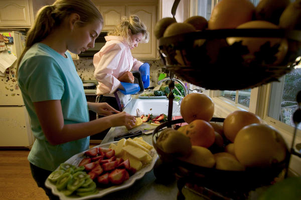 The Hoxie family, who are Adventists in Loma Linda, Calif., prepare dinner. Seventh-day Adventists follow a diet that emphasizes nuts, fruits and legumes and is low in sugar, salt and refined grains.