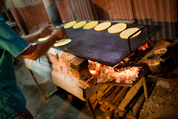 Mazie Nixtamal tortillas are a staple of the Nicoyan diet in Costa Rica. They're made fresh daily with corn soaked in lime and water (calcium hydroxide), which infuses the grain with 7.5 times more calcium and unlocks certain amino acids otherwise unavailable in the corn.