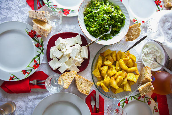 A distinct version of the Mediterranean diet is followed on the Blue Zone island of Ikaria, Greece. It emphasizes olive oil, vegetables, beans, fruit, moderate amounts of alcohol and low quantities of meat and dairy products.