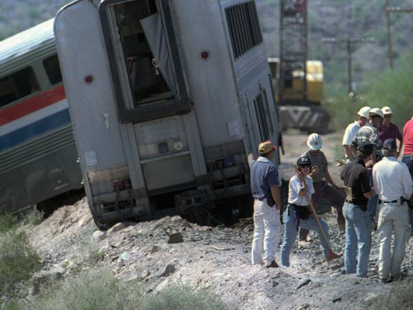 Federal investigators continue to search for clues beside the track on Oct. 11, 1995.