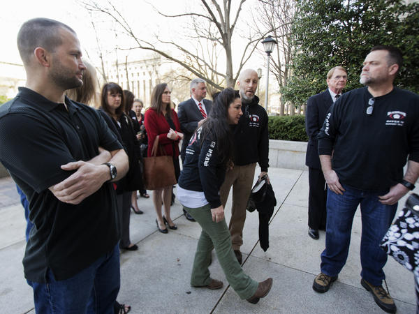 Supporters of four former Blackwater security guards in front of a federal courthouse in Washington, D.C., on Monday.