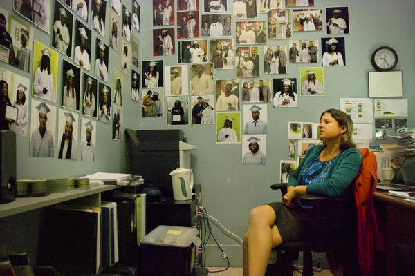 Elizabeth Ostberg, founding principal of The NET, has decorated her office with photos of students who have graduated.
