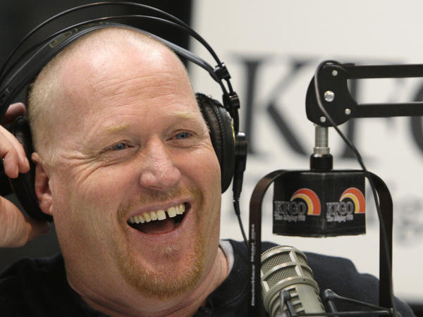 Joel Heitkamp smiles while broadcasting in 2009 at AM radio station KFGO in Fargo, N.D.
