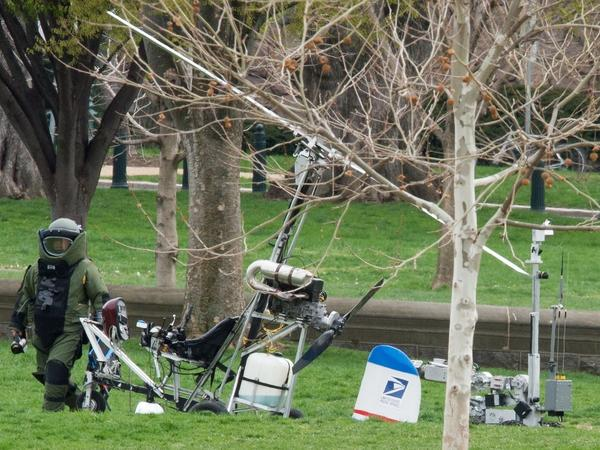 An explosive ordnance disposal technician checks the gyrocopter that landed on the Capitol's South Lawn Wednesday.