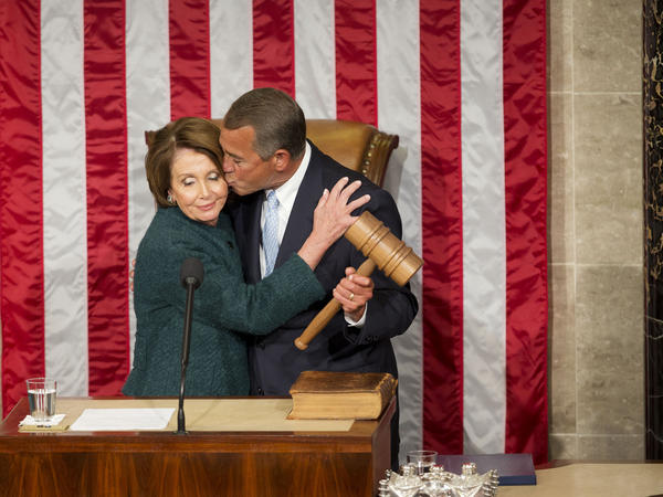 House Speaker John Boehner of Ohio kisses Rep. Nancy Pelosi during the opening session of the 114th Congress.