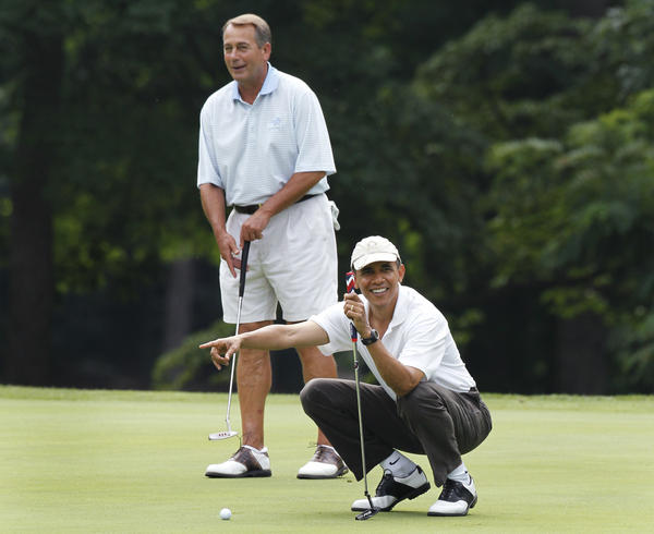 President Obama points to Vice President Biden's putt as they and House Speaker John Boehner, R-Ohio, golf at Andrews Air Force Base, Md., in June 2011.