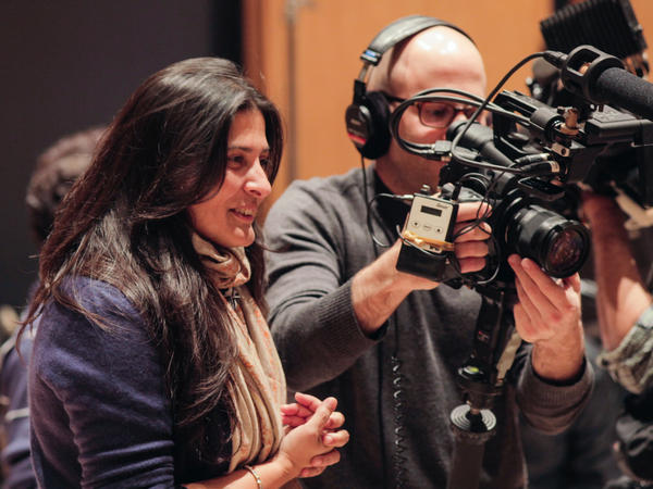 Oscar-winning filmmaker Sharmeen Obaid-Chinoy, left, co-directed<em> Song of Lahore</em> with producer Andy Schocken, right.