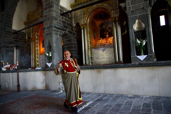 An Armenian deacon carries an incense burner during Easter mass at St. Giragos Church in Diyarbakir, in southeastern Turkey, in April. Some Armenians who survived a slaughter at the hands of the Ottomans a century ago were raised by Muslim families. Some descendants of those 'hidden Armenians' are now reclaiming their heritage.