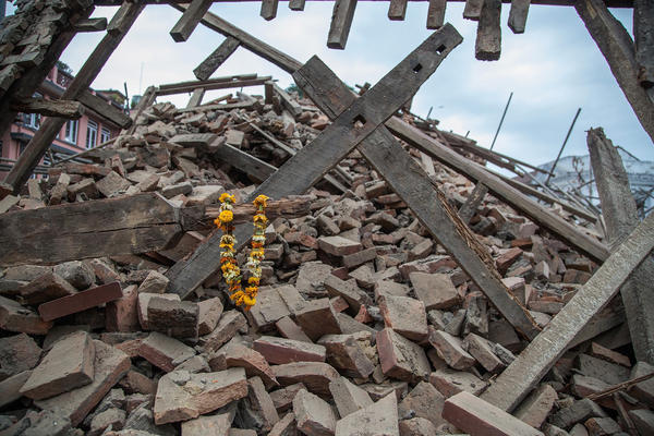 Flowers are left by survivors on top of debris from a collapsed building at Basantapur Durbar Square following the earthquake.