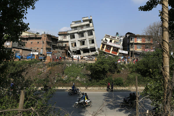 Damaged buildings tilt precariously in Kathmandu. The magnitude 7.8 earthquake shook Nepal's capital and the densely populated Kathmandu Valley, causing extensive damage.
