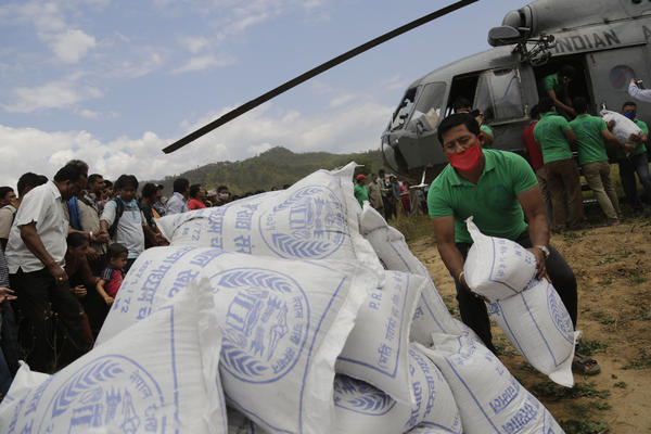 Nepali volunteers unload supplies brought by an Indian air force helicopter for victims of the earthquake at Trishuli Bazar in Nepal. The earthquake has left nearly 1 million children in need of humanitarian aid, according to UNICEF.