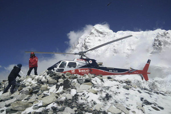 A helicopter was used to try to rescue people from Camps 1 and 2 at Everest Base Camp. The quake also triggered a massive avalanche that buried climbers on Mount Everest, killing more than a dozen people.<br /><br />