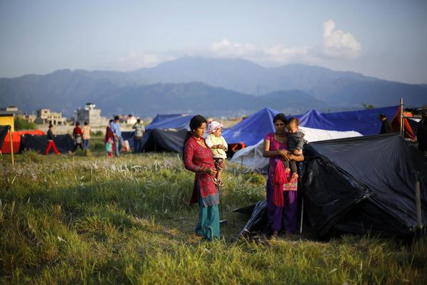 Displaced families set up tents in a field opposite the airport in Kathmandu. In one district, 400,000 people were affected by the quake and more than 4,000 homes are now unsafe to inhabit, NPR's Julie McCarthy reports.