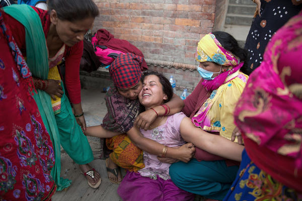 A Nepalese woman mourns the death of her 9-year-old son during a cremation ceremony in the Pashupatinath temple in Kathmandu.