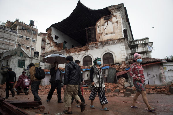 People walk in front of one of Kathmandu's oldest high schools, which was damaged in the earthquake.