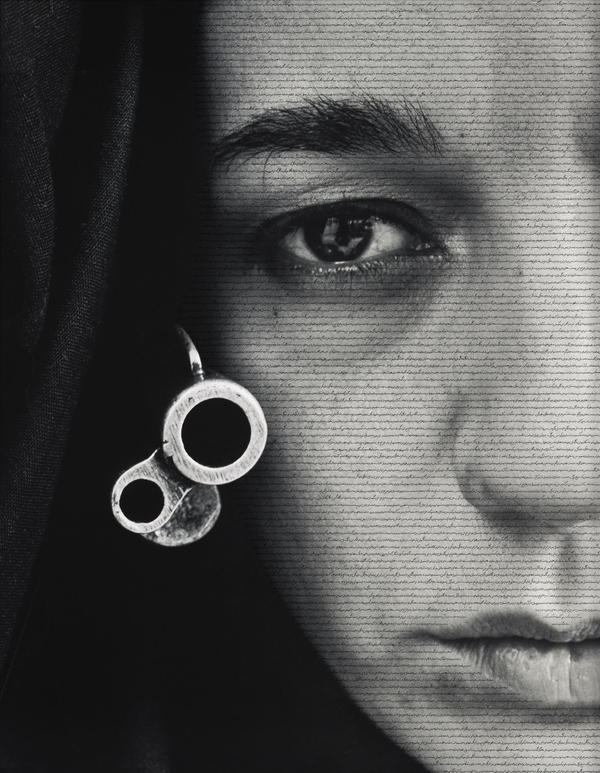 "<a href=""http://media.npr.org/assets/img/2015/04/28/m2012_60_labeled_custom.jpg"" target=""_blank"">Click here</a> to see the tiny script printed on the face of the veiled warrior in Shirin Neshat's 1996 work<em> Speechless.</em>"