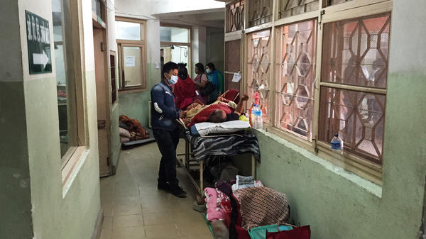 Doctors treat earthquake victims in the Model Hospital in Kathmandu, Nepal. There are more than 150 patients being treated in a hospital that can only handle 125.
