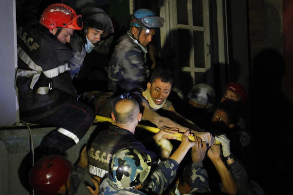 Rishi Khanal is rescued by French emergency workers from the ruins of a three-story hotel in the Gangabu area of Kathmandu. Nearly 11,000 more were injured, according to Nepal's National Emergency Operation Center.