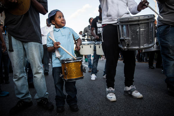 A boy performs in a drum line during a protest in Baltimore. The city's public schools were closed for the day.