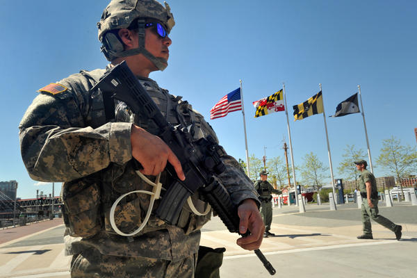 "The 175th Infantry of the Maryland National Guard is stationed along the Inner Harbor. Maryland Gov. Larry Hogan said National Guard troops and police officers would ""not tolerate violence or looting"" of the kind that shook the city Monday."