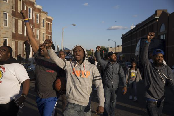 Protesters march at a rally in Baltimore. Monday's violence started hours after the funeral of Freddie Gray, a 25-year-old black man who suffered a serious spine injury while in police custody. His death on April 19 at a hospital led to several days of mostly peaceful protests.
